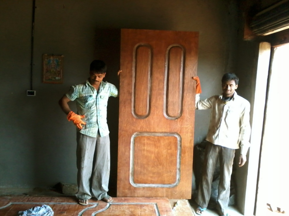 A MOLDED WOOD SUBSTITUTE DOOR